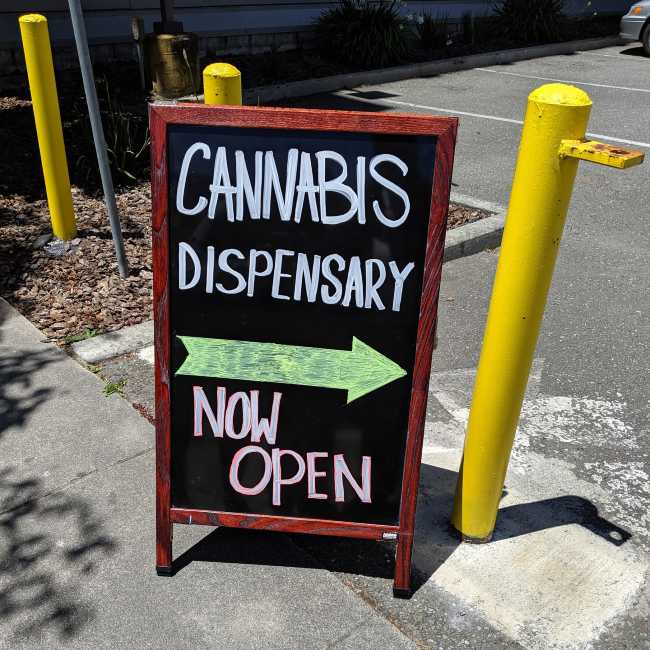Sign reading cannabis dispensary now open