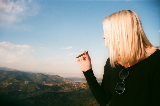 Someone smoking a blunt in a cool smoke spot
