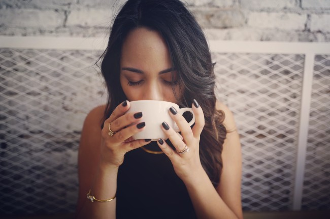 A women sipping coffee