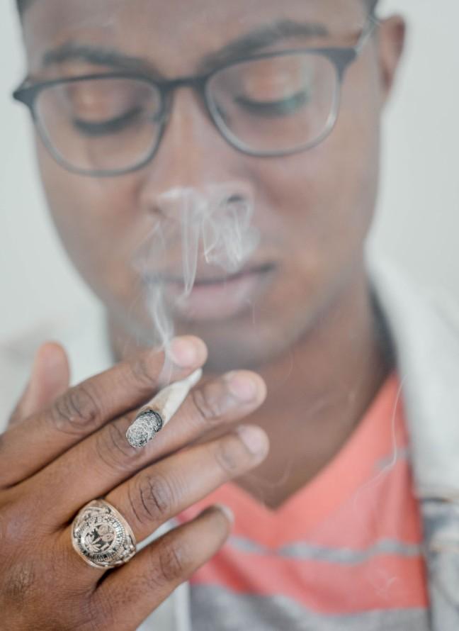 A man smoking a joint