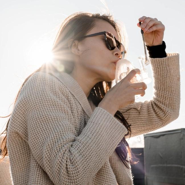 A woman taking a dab