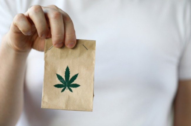 Someone giving someone a bag of cannabis as a 'gift' throught cannabis delivery in Washington DC