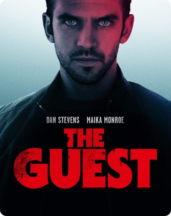 The Guest movie cover with a man staring.
